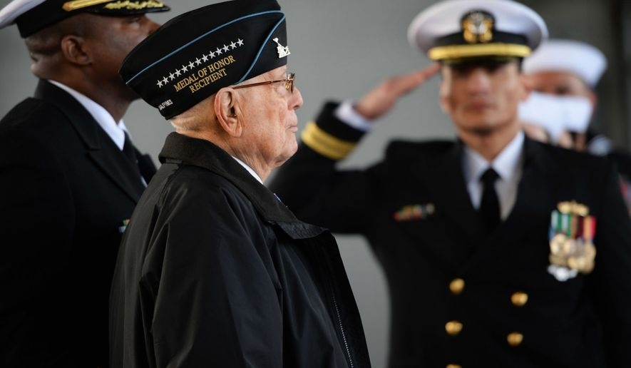 """Medal of Honor Recipient and West Virginia native Hershel """"Woody"""" Williams waits before going up on stage for the ceremony of the Commissioning of the USS Hershel """"Woody"""" Williams in Norfolk, Va., Saturday, March 7, 2020. (Kenny Kemp/Charleston Gazette-Mail via AP)"""