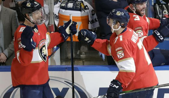 Florida Panthers center Lucas Wallmark (71) is congratulated by defenseman Anton Stralman (6) after Wallmark scored a goal during the second period of an NHL hockey game against the Montreal Canadiens, Saturday, March 7, 2020, in Sunrise, Fla. (AP Photo/Wilfredo Lee)