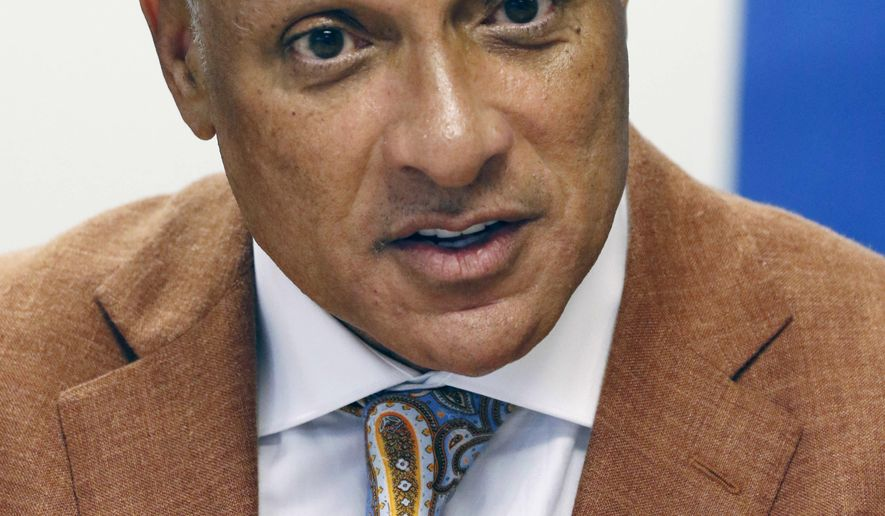 File - In this Oct. 5, 2018, file photo, Mike Espy, a former congressman and former U.S. agriculture secretary, is photographed in Jackson, Miss., and the Democrat will again try to beat incumbent Republican U.S. Sen. Cindy Hyde-Smith, after losing a competitive race to her in the 2018 special election. However, he must first beat two opponents in his party's primary on Tuesday, March 10. (AP Photo/Rogelio V. Solis, File)
