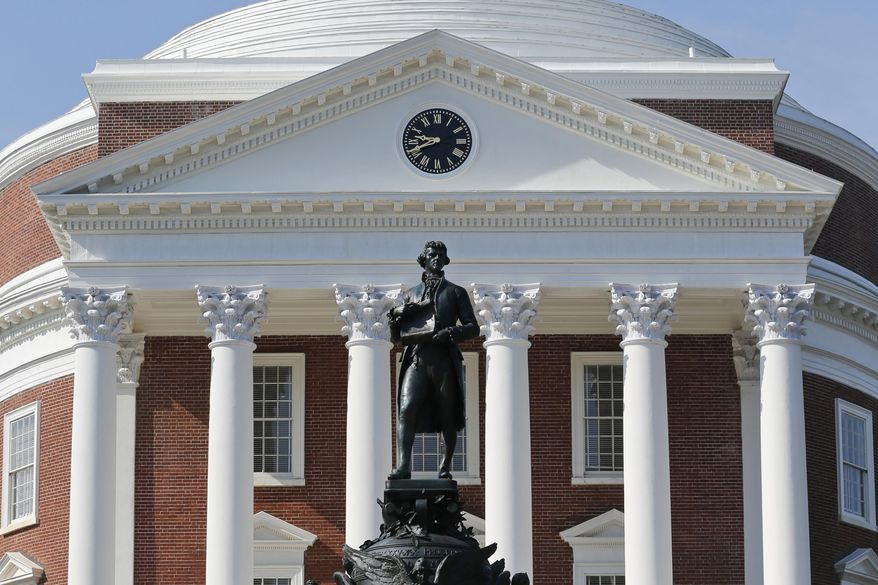 FILE - In this Aug. 6, 2018, file photo, a statue of Thomas Jefferson stands in front of the Rotunda on the campus of the University of Virginia in Charlottesville, Va. For the first time since World War II, Charlottesville won't honor the Founding Father's birthday this spring. Instead, the city will celebrate the demise of the institution with which Jefferson increasingly has become associated: slavery. (AP Photo/Steve Helber, File)