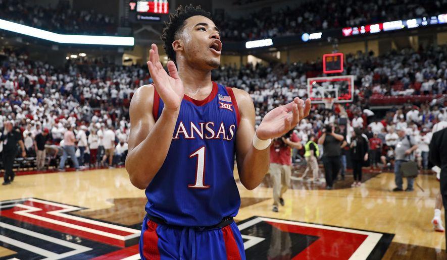 Kansas' Devon Dotson (1) celebrates after an NCAA college basketball game against Texas Tech, Saturday, March 7, 2020, in Lubbock, Texas. (AP Photo/Brad Tollefson)