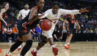 Oregon State's Madison Washington, left, and Stanford's Nadia Fingall (4) vie for the ball during the second half of an NCAA college basketball game in the quarterfinal round of the Pac-12 women's tournament Friday, March 6, 2020, in Las Vegas. (AP Photo/John Locher)