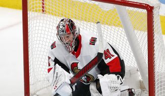 Ottawa Senators goaltender Craig Anderson makes a save against the San Jose Sharks during the third period of an NHL hockey game in San Jose, Calif., Saturday, March 7, 2020. (AP Photo/Josie Lepe) **FILE**