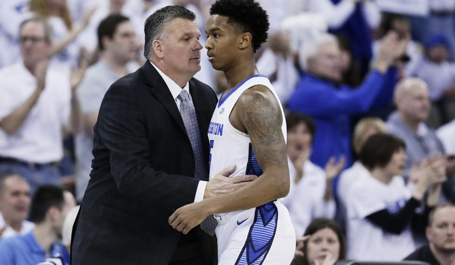 Creighton coach Greg McDermott talks to Ty-Shon Alexander (5) during the first half of an NCAA college basketball game against Seton Hall in Omaha, Neb., Saturday, March 7, 2020. (AP Photo/Nati Harnik)