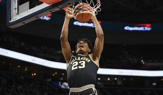 Villanova forward Jermaine Samuels (23) dunks during the first half of an NCAA college basketball game against Georgetown, Saturday, March 7, 2020, in Washington. (AP Photo/Nick Wass)