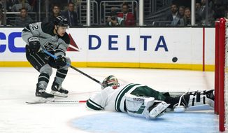 Los Angeles Kings center Trevor Moore, left, scores on Minnesota Wild goaltender Alex Stalock during the second period of an NHL hockey game Saturday, March 7, 2020, in Los Angeles. (AP Photo/Mark J. Terrill)