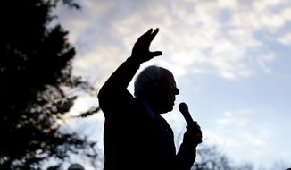 Rep. Alexandria Ocasio-Cortez , D-NY., Democratic presidential candidate Sen. Bernie Sanders, I-Vt., speaks during a campaign rally at the University of Michigan in Ann Arbor, Mich., Sunday, March 8, 2020. (AP Photo/Paul Sancya)