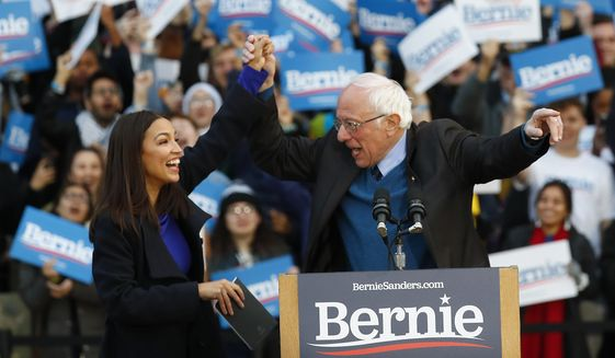 U.S. Rep. Alexandria Ocasio-Cortez , D-N.Y., introduces Democratic presidential candidate U.S. Sen. Bernie Sanders, I-Vt., during a campaign rally at the University of Michigan in Ann Arbor, Mich., Sunday, March 8, 2020. (AP Photo/Paul Sancya)