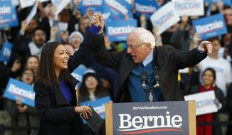 U.S. Rep. Alexandria Ocasio-Cortez , D-N.Y., introduces Democratic presidential candidate U.S. Sen. Bernie Sanders, I-Vt., during a campaign rally at the University of Michigan in Ann Arbor, Mich., Sunday, March 8, 2020. (AP Photo/Paul Sancya)