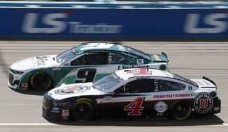 Kevin Harvick (4) races Chase Elliott (9) for the lead through Turn 4 during a NASCAR Cup Series auto race at Phoenix Raceway, Sunday, March 8, 2020, in Avondale, Ariz. (AP Photo/Ralph Freso) **FILE**