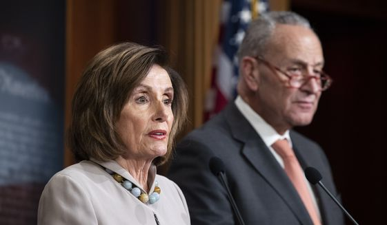 In this Tuesday, Feb. 11, 2020, file photo, House Speaker Nancy Pelosi, of California, joined by Senate Minority Leader Chuck Schumer of N.Y., speaks during a news conference, on Capitol Hill, in Washington.  (AP Photo/Alex Brandon, File)  **FILE**