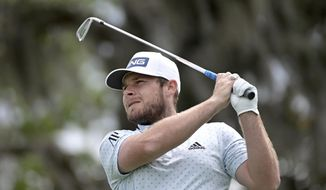 Tyrrell Hatton, of England, watches his tee shot on the second hole during the final round of the Arnold Palmer Invitational golf tournament, Sunday, March 8, 2020, in Orlando, Fla. (AP Photo/Phelan M. Ebenhack)
