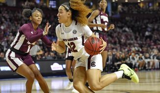South Carolina's Brea Beal (12) drives while defended by Mississippi State's Myah Taylor (1) during a championship match at the Southeastern conference women's NCAA college basketball tournament in Greenville, S.C., Sunday, March 8, 2020. (AP Photo/Richard Shiro)