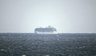 The Regal Princess Cruise ship is seen at sea about 5 miles off the coast of Fort Lauderdale, Fla., Sunday, March 8, 2020. The cruise ship was being held off the coast of Florida Sunday as the ship waits for test results on whether two crew members have contracted the new coronavirus. The crew members in question had transferred from the Grand Princess cruise ship in California where nearly two dozen on board have tested positive for the virus, including multiple crew members. (Joe Cavaretta/South Florida Sun-Sentinel via AP)