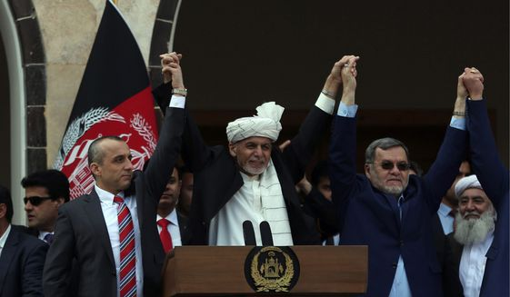 Afghan President Ashraf Ghani (center) held his inauguration with second Vice President Sarwar Danish (right) and first Vice President Amrullah Salehnistan on Monday. (ASSOCIATED PRESS)
