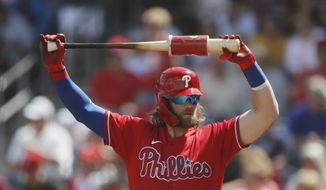 Philadelphia Phillies' Bryce Harper stretches during a spring training baseball game, Monday, March 9, 2020, in Clearwater, Fla. (AP Photo/Carlos Osorio) ** FILE **
