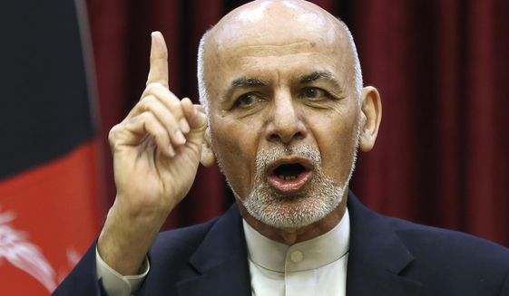 In this March 1, 2020, file photo, Afghan President Ashraf Ghani speaks during a news conference in the presidential palace in Kabul, Afghanistan. (AP Photo/Rahmat Gul, File)