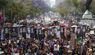 Women march during International Women's Day in Mexico City, Sunday, March 8, 2020. Protests against gender violence in Mexico have intensified in recent years amid an increase in killings of women and girls. (AP Photo/Eduardo Verdugo)