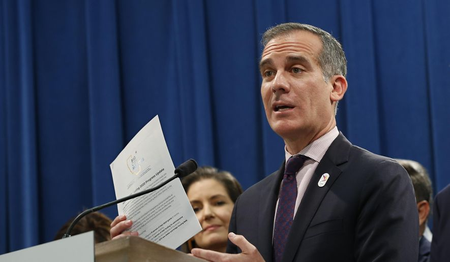 Los Angeles Mayor Eric Garcetti, discusses the meeting concerning the state's homeless situation he and other mayors of some of California's largest cities had with Gov. Gavin Newsom at the Capitol in Sacramento, Calif., Monday, March 9, 2020. (AP Photo/Rich Pedroncelli)
