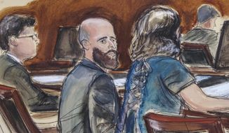 In this courtroom sketch Joshua Schulte, center, is seated at the defense table flanked by his attorneys during jury deliberations, Wednesday March 4, 2020, in New York. (Elizabeth Williams via AP)