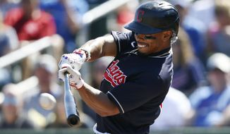 Cleveland Indians' Francisco Lindor connects for a home run against the Chicago Cubs during the first inning of a spring training baseball game Saturday, March 7, 2020, in Goodyear, Ariz. (AP Photo/Ross D. Franklin)