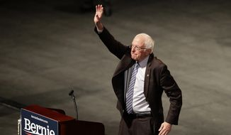 Democratic presidential candidate Sen. Bernie Sanders, I-Vt., waves to supporters during a campaign rally Monday, March 9, 2020, in St. Louis. (AP Photo/Jeff Roberson)