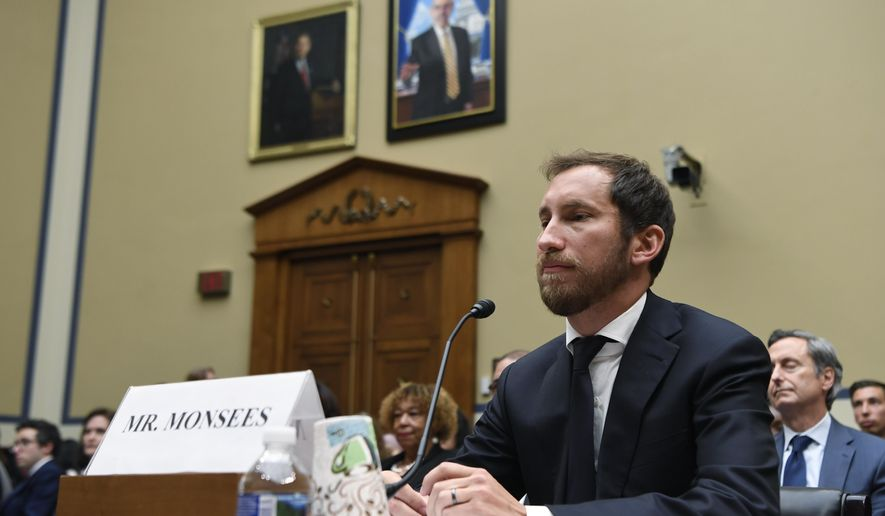 In this July 25, 2019, file photo, Juul Labs co-founder and Chief Product Officer James Monsees testifies before a House Oversight and Government Reform subcommittee on Capitol Hill in Washington, during a hearing on the youth nicotine epidemic. Vaping giant Juul Labs has donated thousands of dollars to court state attorneys general. But the lobbying strategy may be backfiring. (AP Photo/Susan Walsh, file)