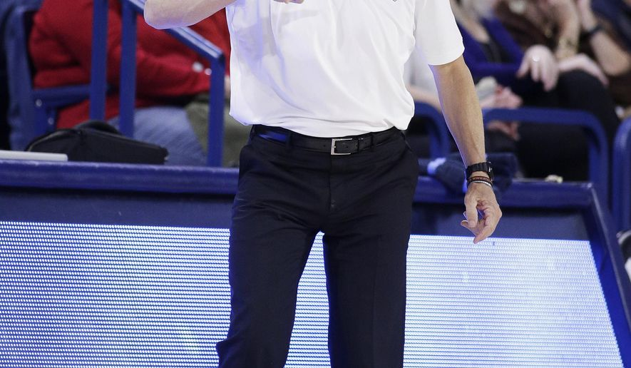 Loyola Marymount coach Mike Dunlap shouts to his players during the second half of an NCAA college basketball game against Gonzaga in Spokane, Wash., Thursday, Feb. 6, 2020. Gonzaga won 85-67. (AP Photo/Young Kwak)