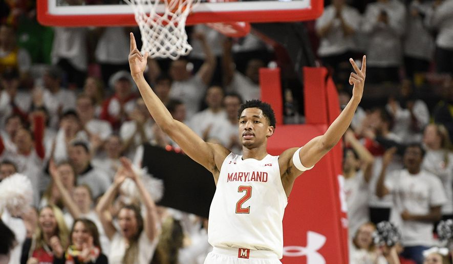 Maryland guard Aaron Wiggins (2) reacts after he made a three-point basket during the second half of an NCAA college basketball game against Michigan, Sunday, March 8, 2020, in College Park, Md. (AP Photo/Nick Wass) **FILE**