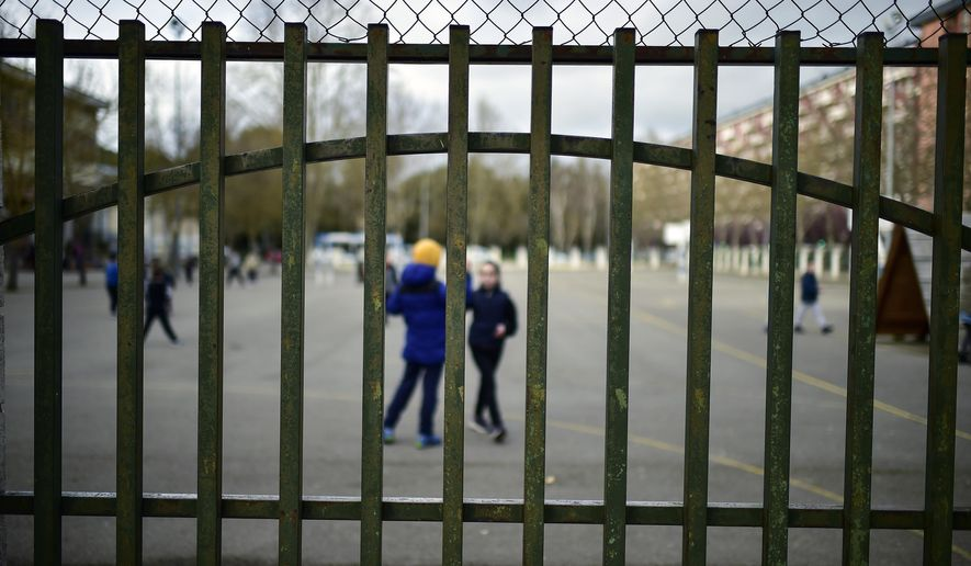 Young students play in a public school, in Vitoria, northern Spain, Monday, March 9, 2020. Health authorities in the Madrid region say that infections for the new coronavirus have more than doubled in the past 24 hours. (AP Photo/Alvaro Barrientos)