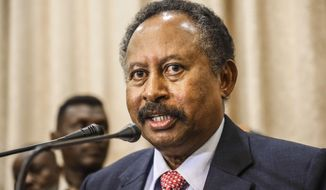 In this Aug. 21, 2019, file photo, Sudan's new Prime Minister Abdalla Hamdok speaks during a press conference in Khartoum, Sudan. Sudan's state media Monday, March 9, 2020, says Hamdok has survived an assassination attempt after a blast in the capital Khartoum. (AP Photo, File)