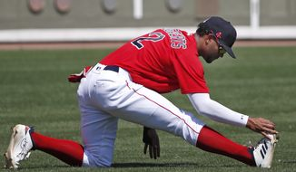 Boston Red Sox's Xander Bogaerts stretches before a spring training baseball game against the Detroit Tigers, Wednesday, March 4, 2020, in Fort Myers, Fla. (AP Photo/Elise Amendola)