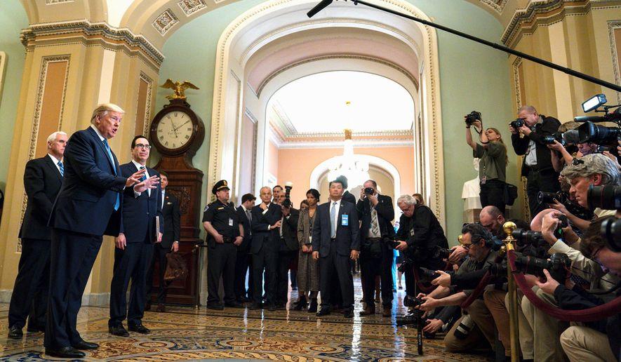 Vice President Mike Pence, Treasury Secretary Steven Mnuchin and President Trump face the press about coronavirus. (Associated Press)