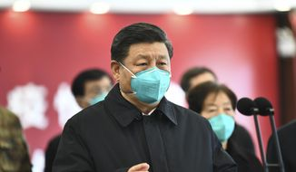 In this photo released by China's Xinhua News Agency, Chinese President Xi Jinping talks by video with patients and medical workers at the Huoshenshan Hospital in Wuhan in central China's Hubei Province, Tuesday, March 10, 2020. China's president visited the center of the global virus outbreak Tuesday as Italy began a sweeping nationwide travel ban and people worldwide braced for the possibility of recession. For most people, the new coronavirus causes only mild or moderate symptoms, such as fever and cough. For some, especially older adults and people with existing health problems, it can cause more severe illness, including pneumonia. (Xie Huanchi/Xinhua via AP) **FILE**