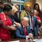 African American leaders say a prayer with President Donald Trump as they end a meeting in the Cabinet Room of the White House, Thursday, Feb. 27, 2020, in Washington. (AP Photo/Manuel Balce Ceneta)