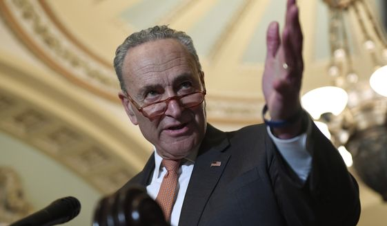 Senate Minority Leader Sen. Chuck Schumer of N.Y., talks with reporters on Capitol Hill in Washington, Tuesday, March 10, 2020, following a Democratic luncheon. (AP Photo/Susan Walsh/File)
