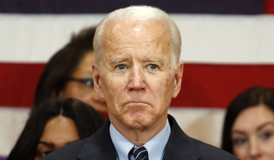 Democratic presidential candidate and former Vice President Joe Biden waits to deliver his speech during a campaign event in Columbus, Ohio. Tuesday, March 10, 2020. (AP Photo/Paul Vernon)