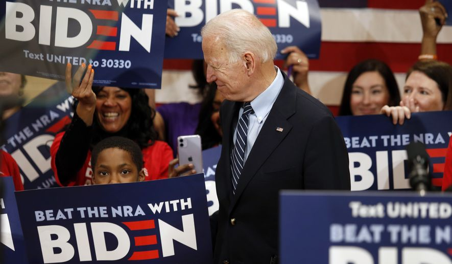 Democratic presidential candidate former Vice President Joe Biden enters a campaign event in Columbus, Ohio, Tuesday, March 10, 2020. (AP Photo/Paul Vernon)