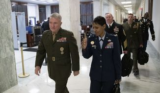 U.S. Marine Corps Gen. Kenneth McKenzie Jr., commander of U.S. Central Command, left, walks to a House Armed Services hearing, on Capitol Hill, Tuesday, March 10, 2020, in Washington. (AP Photo/Alex Brandon) ** FILE **