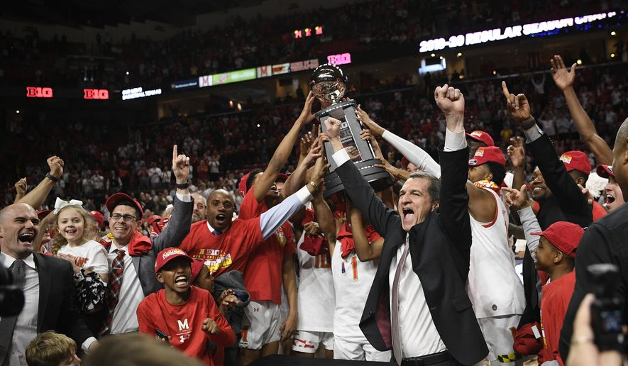 Maryland head coach Mark Turgeon, right center, and his team celebrate after they won a share of the Big Ten regular season title after defeating Michigan in an NCAA college basketball game, Sunday, March 8, 2020, in College Park, Md. Maryland won 83-70. (AP Photo/Nick Wass)  **FILE**