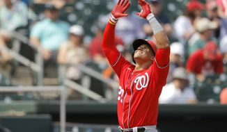 Washington Nationals' Juan Soto reacts after hitting a two-run home run off Miami Marlins pitcher Josh A. Smith during the fourth inning of a spring training baseball game, Tuesday, March 10, 2020, in Jupiter, Fla. (AP Photo/Julio Cortez)