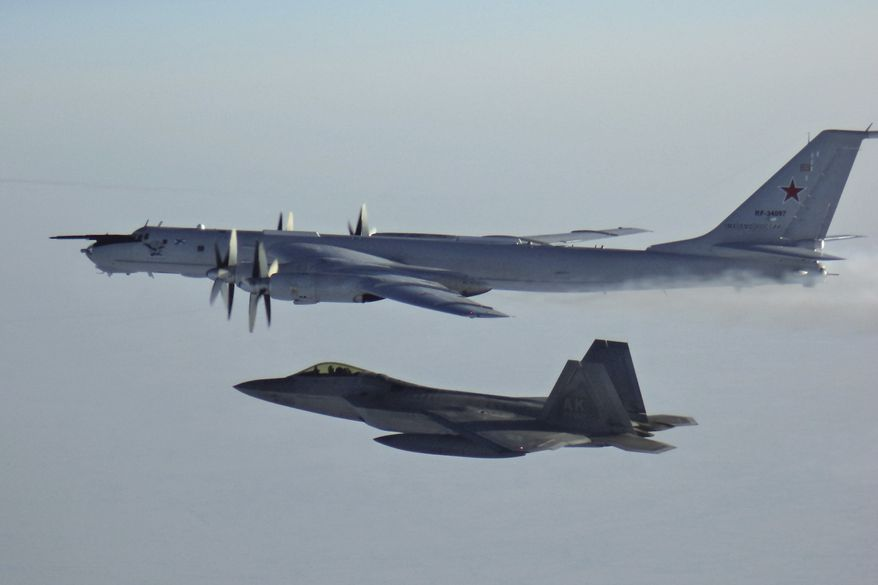 In this Monday, March 9, 2020, file photo released by the North American Aerospace Defense Command (NORAD), a Russian Tu-142 maritime reconnaissance aircraft, top right, is intercepted near the Alaska coastline. U.S. and Canadian aircraft intercepted and escorted two Russian jets that flew over the Beaufort Sea near the Alaska coastline, military officials said Tuesday. The Russian Tu-142 maritime reconnaissance aircraft were escorted by F-22 and CF-18 planes, the North American Aerospace Defense Command said in a release. The Russian jets never left international airspace during the duration of the four-hour flight on Monday, but did come within 50 miles of the Alaska coast. (North American Aerospace Defense Command  via AP)