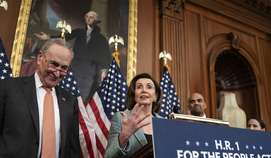 """Senate Minority Leader Chuck Schumer, D-N.Y., left, and Speaker of the House Nancy Pelosi, D-Calif., call on Senate Majority Leader Mitch McConnell, R-Ky., to bring the Democrats' HR-1 """"For the People Act"""" to the floor for a vote, during an event on Capitol Hill in Washington, Tuesday, March 10, 2020. (AP Photo/J. Scott Applewhite) ** FILE **"""
