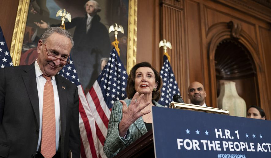 """Senate Minority Leader Chuck Schumer, D-N.Y., left, and Speaker of the House Nancy Pelosi, D-Calif., call on Senate Majority Leader Mitch McConnell, R-Ky., to bring the Democrats' HR-1 """"For the People Act"""" to the floor for a vote, during an event on Capitol Hill in Washington, Tuesday, March 10, 2020. (AP Photo/J. Scott Applewhite)"""