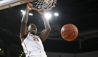 FILE - In this Jan. 18, 2020, file photo, Southern California forward Onyeka Okongwu dunks the ball during the first half of an NCAA college basketball game against Stanford in Los Angeles. Okongwu was selected to the Associated Press All Pac-12 team selected Tuesday, March 10, 2020.(AP Photo/Kelvin Kuo, File)