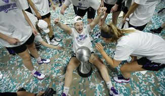 Portland's Keeley Frawley, center, celebrates with teammates after defeating San Diego in an NCAA college basketball game in the final of the West Coast Conference women's tournament Tuesday, March 10, 2020, in Las Vegas. (AP Photo/John Locher)