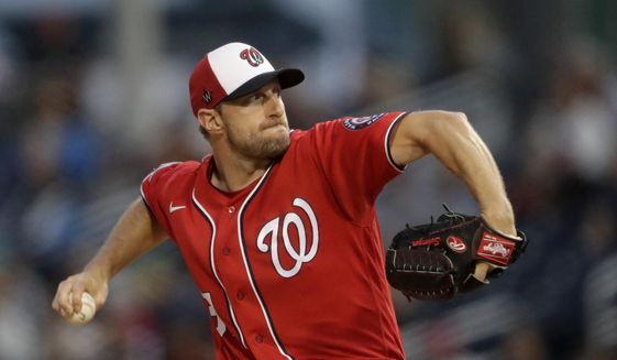 Washington Nationals starting pitcher Max Scherzer (31) works against the Houston Astros during spring training baseball game Saturday, Feb. 22, 2020, in West Palm Beach, Fla. (AP Photo/John Bazemore) ** FILE **