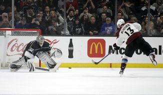 Los Angeles Kings goaltender Jonathan Quick (32) stops a penalty shot from Colorado Avalanche's Valeri Nichushkin (13) during the second period of an NHL hockey game Monday, March 9, 2020, in Los Angeles. (AP Photo/Marcio Jose Sanchez)