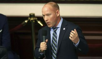 Rep. Spencer Roach, R-North Fort Myers, closes on his sponsored bill to ban the banning of sunscreen containing ingredients that some researchers say harm coral reefs during session Tuesday, March 10, 2020, in Tallahassee, Fla. (AP Photo/Steve Cannon)