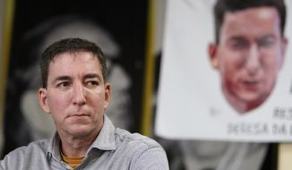 Award-winning journalist Glenn Greenwald listens to a question during a press conference before the start of a protest in his support in front of the headquarters of the Brazilian Press Association, known as ABI, in the city of Rio de Janeiro, Brazil, July 30, 2019. (AP Photo/Ricardo Borges) ** FILE **